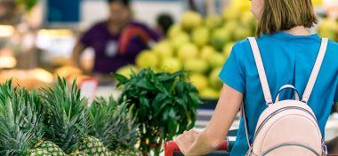 Woman standing beside pineapple fruits 2292919 2