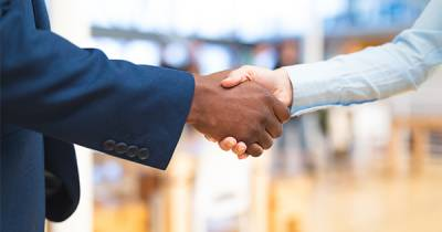Diverse business handshake