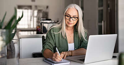 Older women signing paper