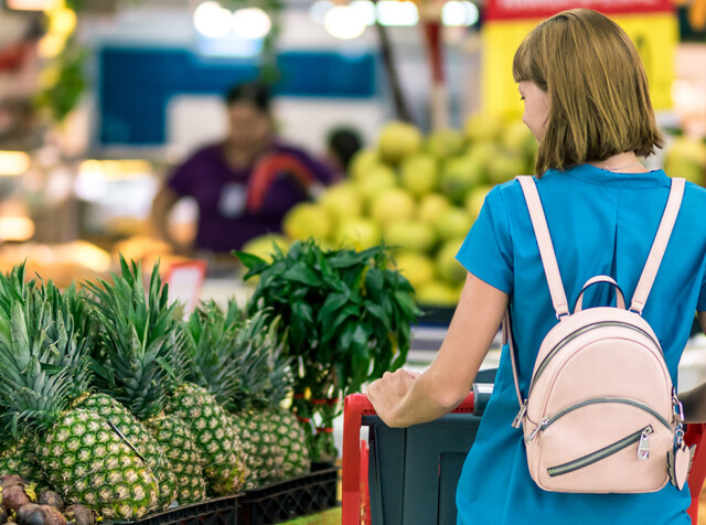 Woman standing beside pineapple fruits 2292919 2