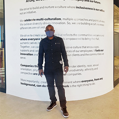 Derrick Coleman in front of GHJ Diversity Wall